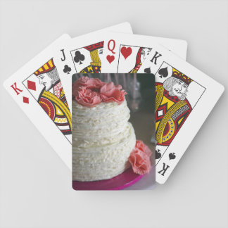 Playing Cards with pink and white cake on the back