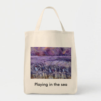 PLAYING IN THE SEA GROCERY TOTE BAG