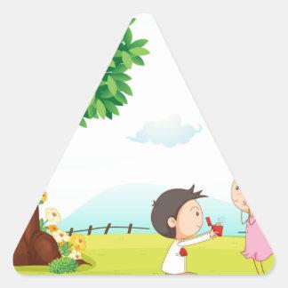 playing kids triangle sticker