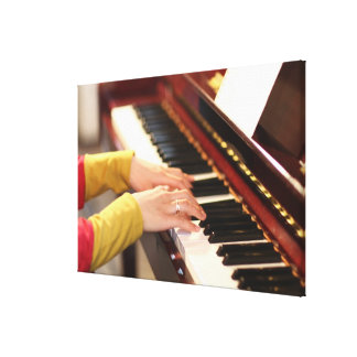 Playing the Piano Canvas Print
