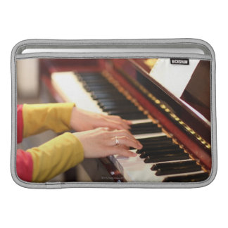Playing the Piano MacBook Sleeve
