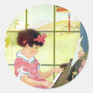 Playing the Piano Round Sticker