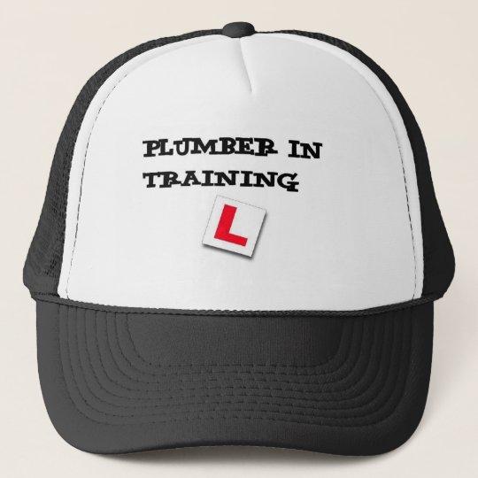 plumber in training cap