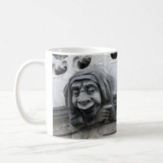 Pointing and face-pulling gargoyles mug
