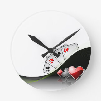 Poker cards and casino symbols round clock