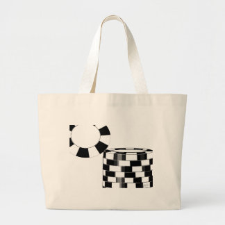 Poker chips in black and white canvas bags