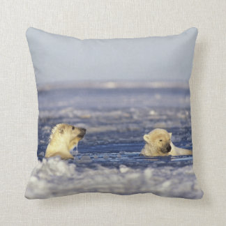 Polar bear cubs playing in pack ice of the throw pillow