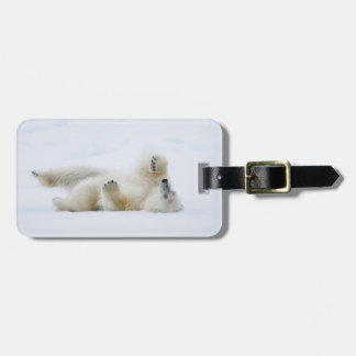 Polar bear rolling in snow, Norway Luggage Tag