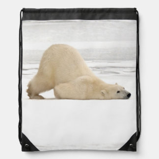 Polar bear scratching itself on frozen tundra drawstring bag