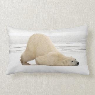 Polar bear scratching itself on frozen tundra lumbar pillow