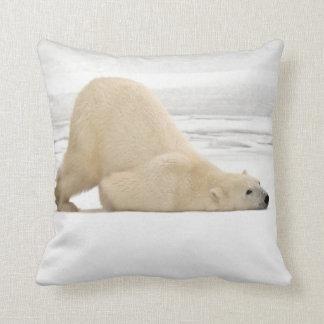 Polar bear scratching itself on frozen tundra throw pillow