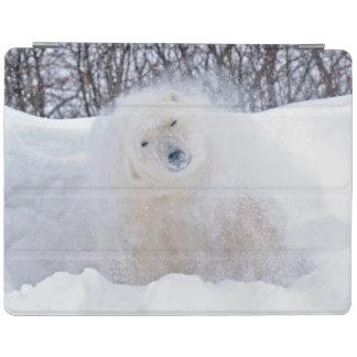 Polar bear shaking snow off on frozen tundra iPad cover