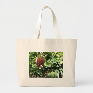 Pomegranate hanging on tree jumbo tote bag