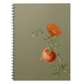 Pomegranate on golden background spiral notebook