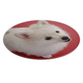 Pomeranian on the Red Carpet Cutting Board