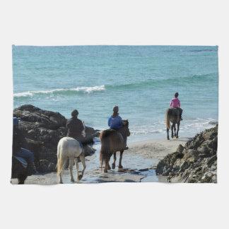 Pony trekking along the beach tea towel