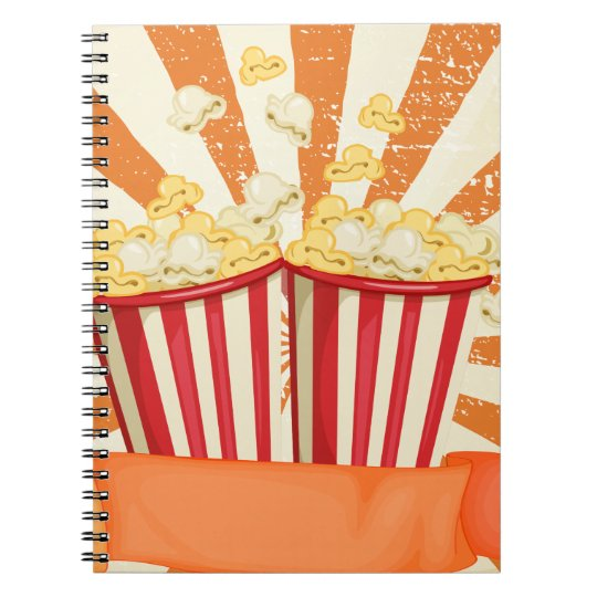 Popcorn in cups with banner notebook