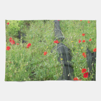 Poppies overgrowing on allotment tea towel