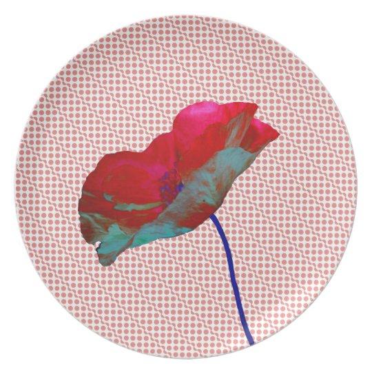 Poppy flower on pink white plate