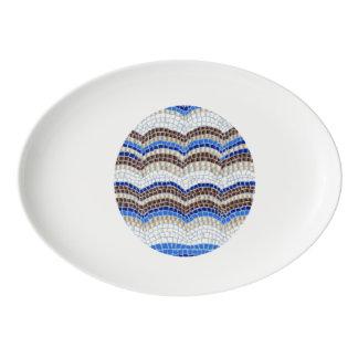 Porcelain coupe platter with blue mosaic porcelain serving platter