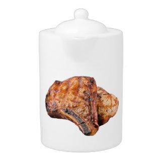 """Pork chop"" design teapots"