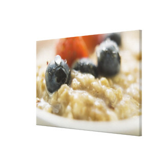 Porridge with berries, close-up canvas print