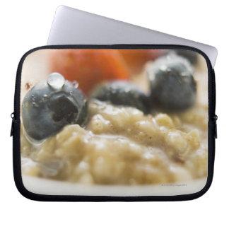 Porridge with berries, close-up laptop sleeve