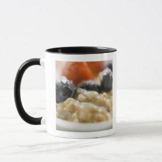 Porridge with berries, close-up mug