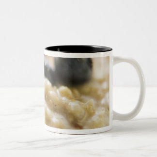 Porridge with berries, close-up Two-Tone coffee mug