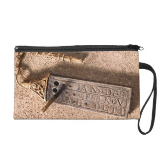 Portable sundial, silver and gold, 10th century (d wristlet clutches