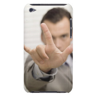 Portrait of a businessman making a hand sign iPod touch case