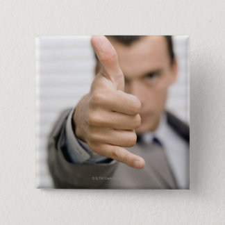 Portrait of a businessman making a thumbs up 15 cm square badge