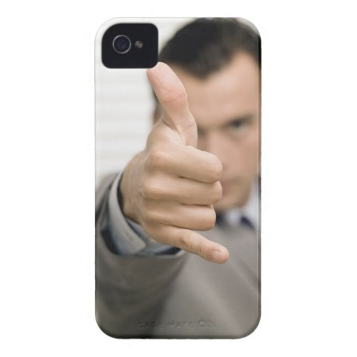 Portrait of a businessman making a thumbs up Case-Mate iPhone 4 cases