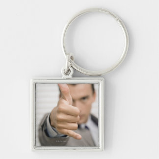 Portrait of a businessman making a thumbs up Silver-Colored square key ring