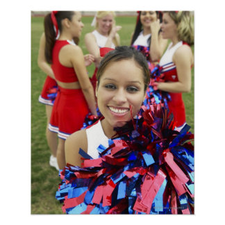 Portrait of a Cheerleader in Front of a Group of Poster