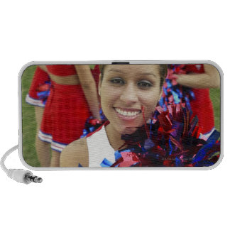 Portrait of a Cheerleader in Front of a Group of Travel Speaker