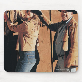 Portrait of a Cowboy and Cowgirl Arranging Reins Mouse Pad