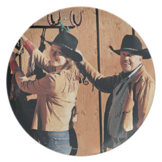 Portrait of a Cowboy and Cowgirl Arranging Reins Plate