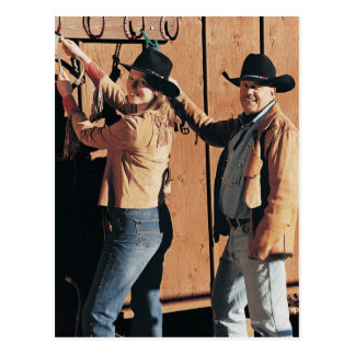 Portrait of a Cowboy and Cowgirl Arranging Reins Postcard