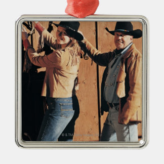 Portrait of a Cowboy and Cowgirl Arranging Reins Silver-Colored Square Decoration