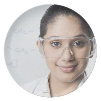 Portrait of a female lab technician wearing a dinner plates