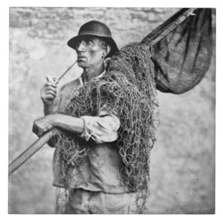 Portrait of a Fisherman Carrying his Nets (b/w pho Tile