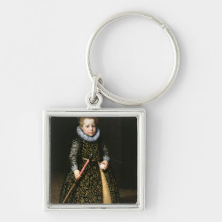 Portrait of a four-year old boy with club and Silver-Colored square key ring