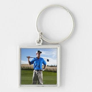 Portrait of a golfer on a sunny day. key ring
