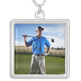 Portrait of a golfer on a sunny day. silver plated necklace