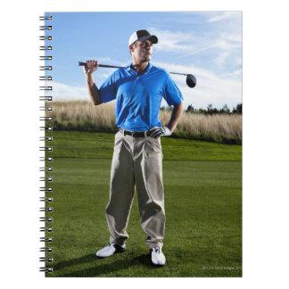Portrait of a golfer on a sunny day. spiral notebook