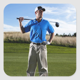 Portrait of a golfer on a sunny day. square sticker