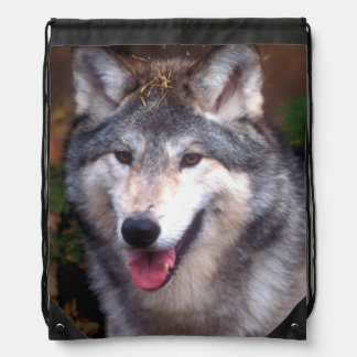 Portrait of a gray wolf drawstring bag