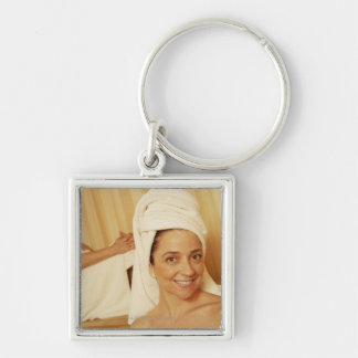 Portrait of a mature woman smiling with another Silver-Colored square key ring
