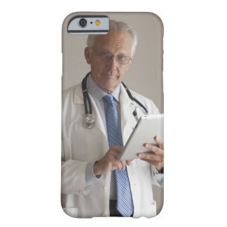 Portrait of a medical doctor holding a barely there iPhone 6 case